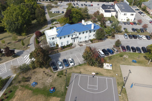Aerial shot of the front of Rosary hall, part of the basketball and volleyball court are visible