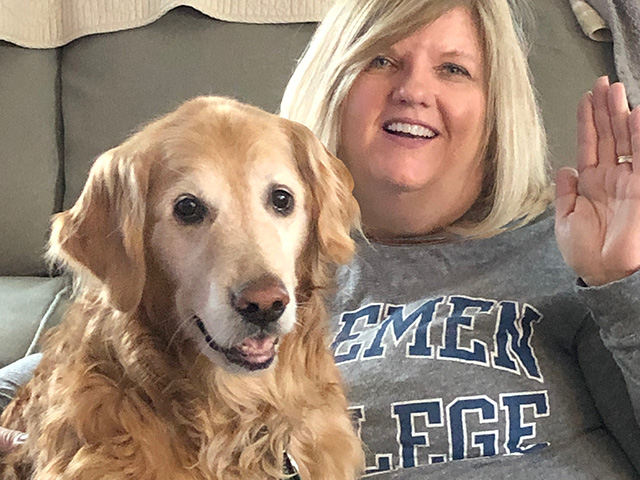 Joyce Strobel with golden retreiver