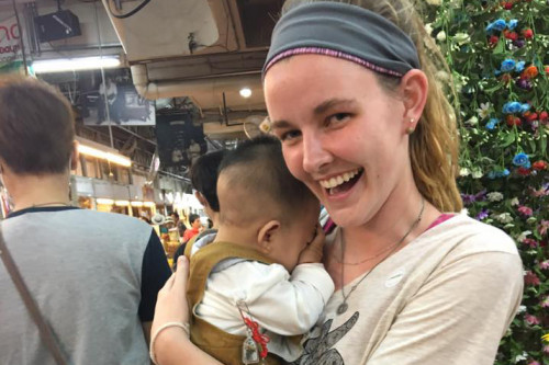 Monica Schubbe holding a baby in Thailand