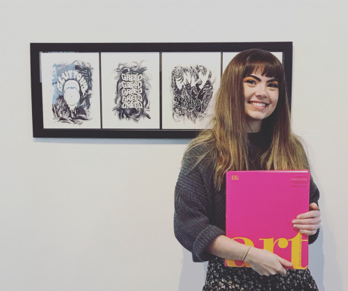 Female student holding a pink book that says art on it infront of 4 pictures