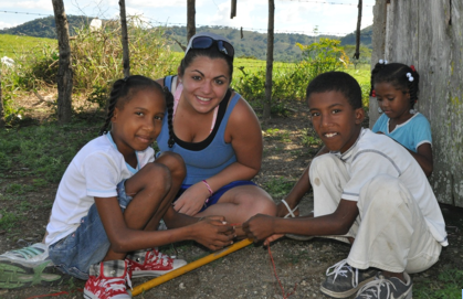 Daemen student playing with Dominican children