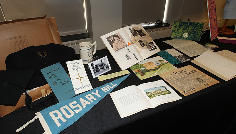 College Memorabilia from Rosary Hill Era spread out on a table
