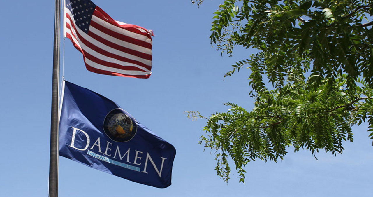 American flag and Daemen flag